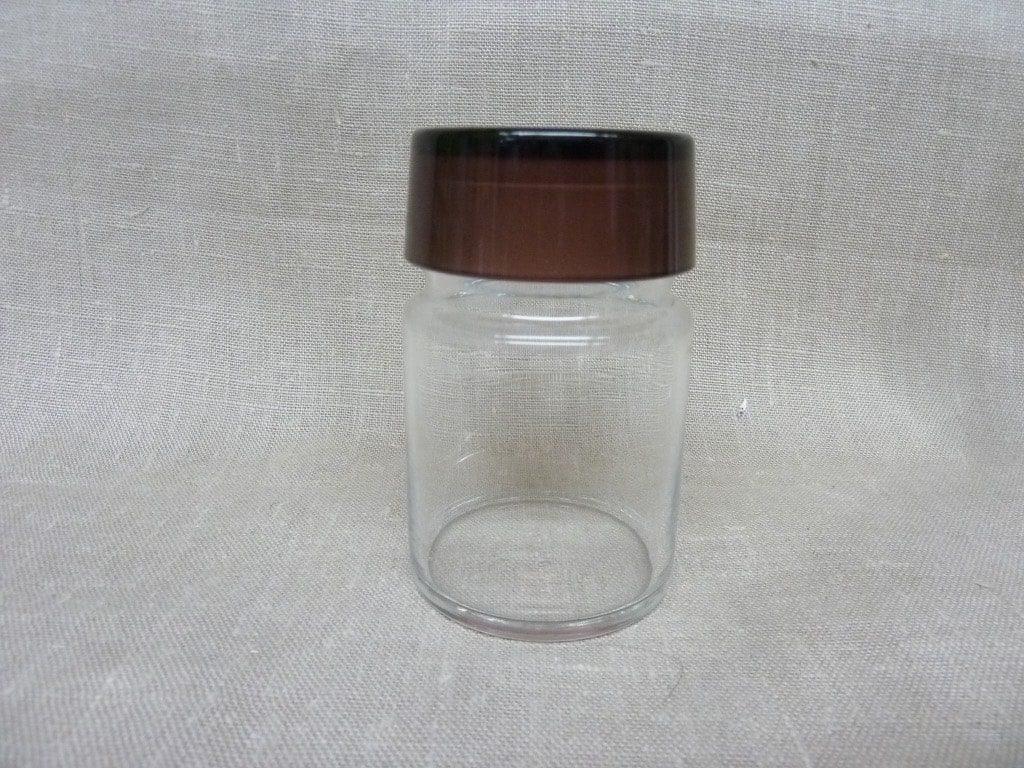Riihimäen lasi maustepurkki, lila, suunnittelija Saara Hopea, lasinen, korkki