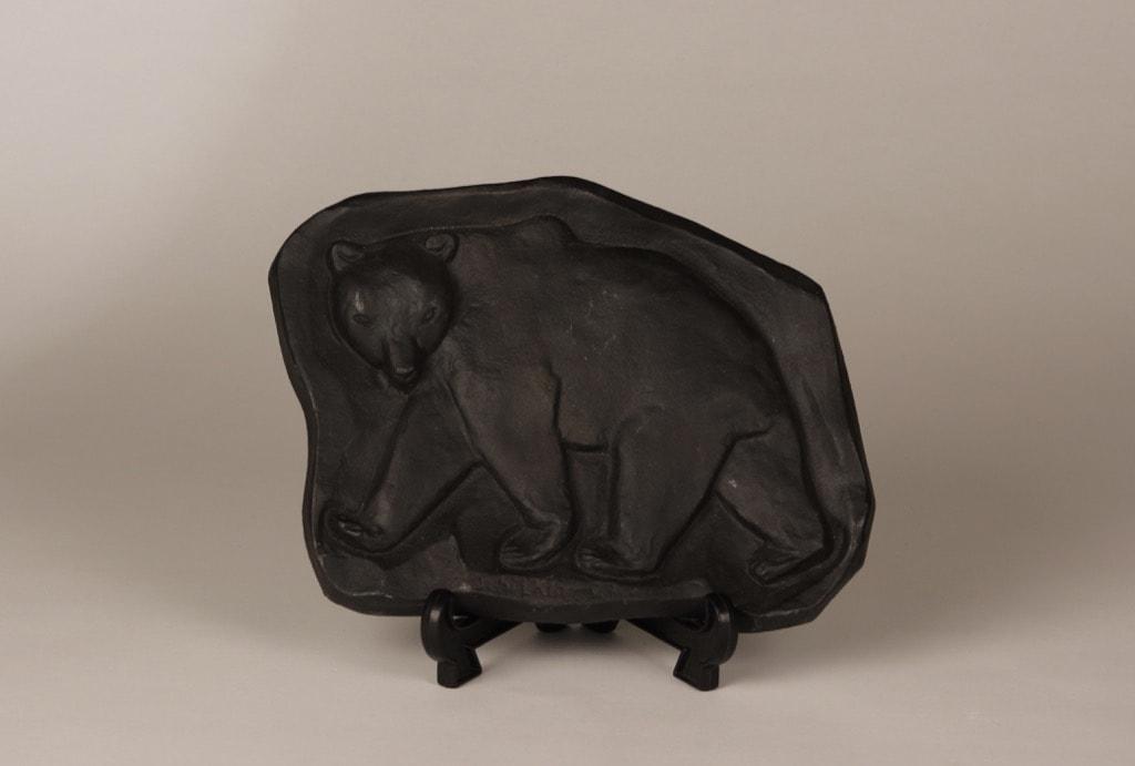 Karhu wall plate, black, designer Michael Schilkin, cast-iron