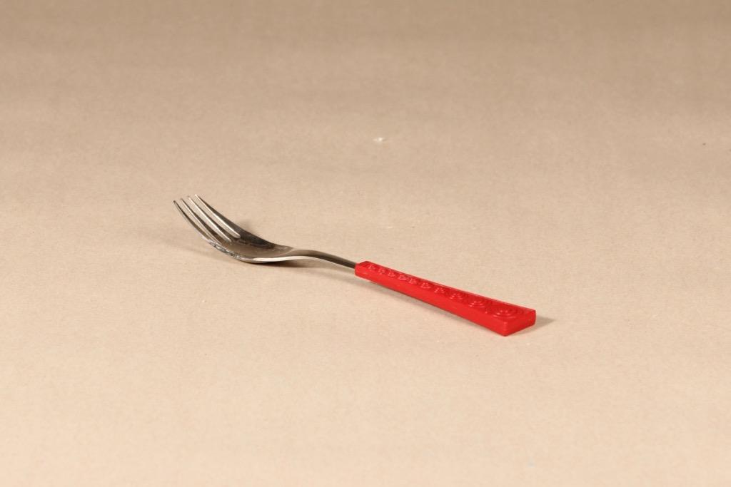 Hackman Colorina haarukka, punainen, teräs, suunnittelija Nanny Still,